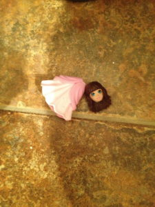 This disturbing decapitated Polly Pockets doll was on the bathroom floor. Creepy.
