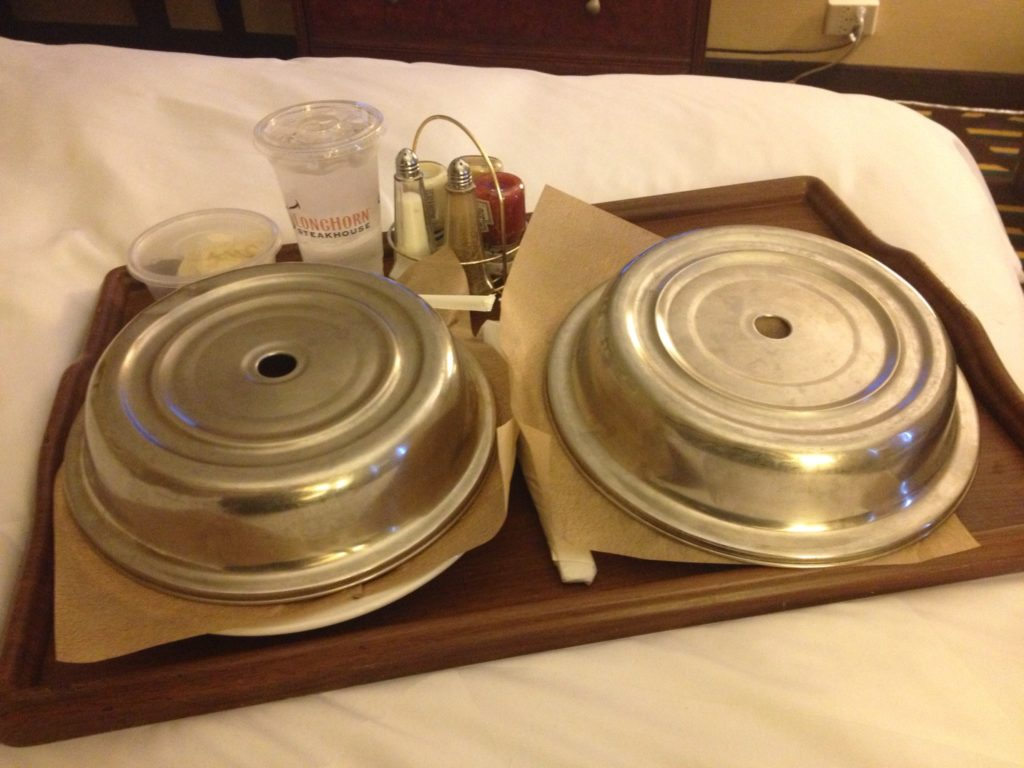 Room service. Chocolate cake in bed makes a decent silver lining, eh?