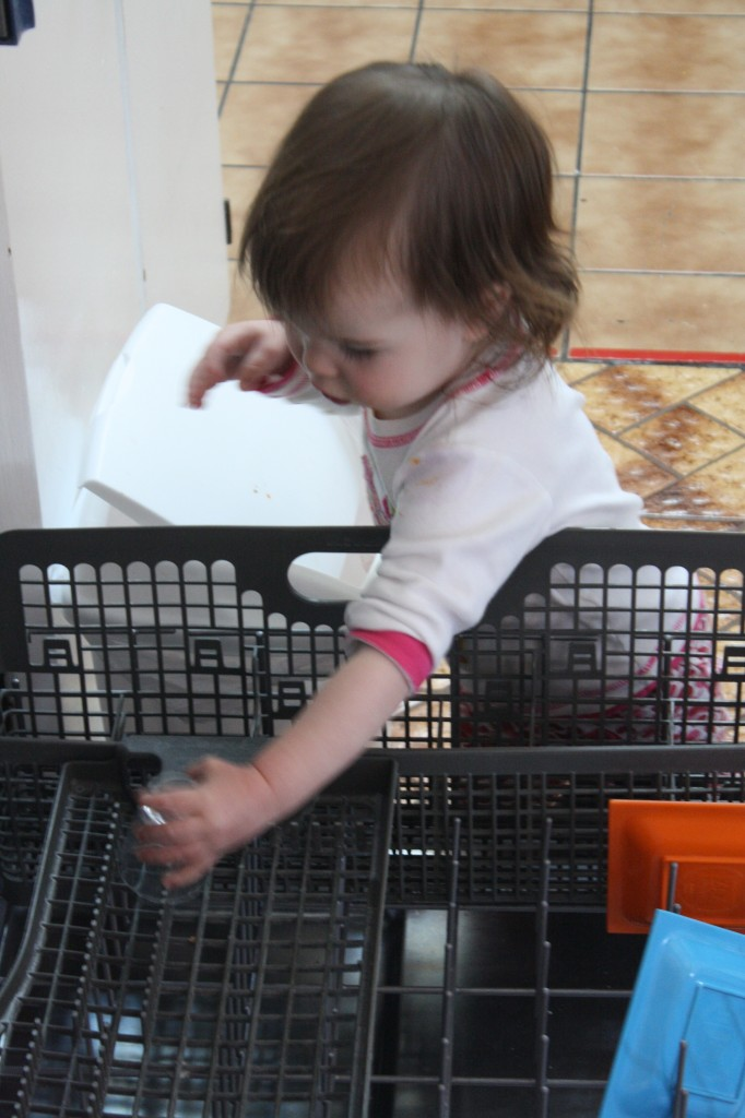 My toddler loading the dishwasher at childcare.