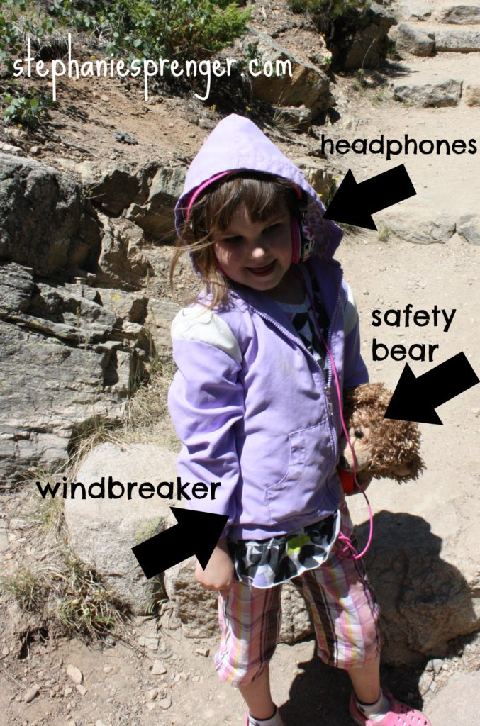 Izzy models the hiking protocol necessities.
