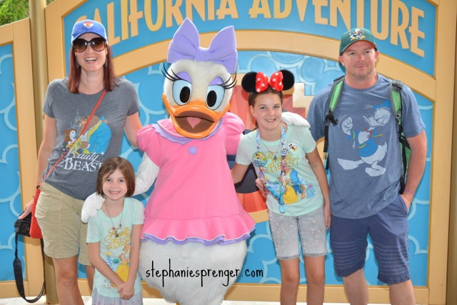 Daisy Duck at Disneyland with kids how-to-have-a-great-time-at-disneyland-with-kids-without-stress